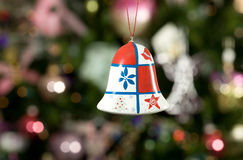Christmas bell with treeon background Royalty Free Stock Image