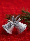Christmas bells. Chrismas bells and green needles Royalty Free Stock Photos