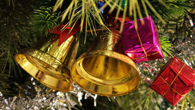 Christmas Bells. Beautiful golden christmas bells and gift boxes in a Christmas tree. Beautiful addition for your congratulatory card Stock Images