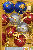 Christmas bells. Colored Christmas bells with stips Royalty Free Stock Photography