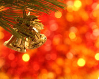 Christmas bells. Gold Christmas bells on pine bough Stock Photo