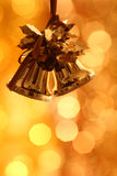 Christmas bells. Against gold blurred background Stock Photo