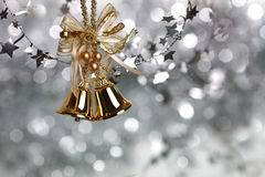 Christmas bells. Christmas tree decoration on silver light background stock images