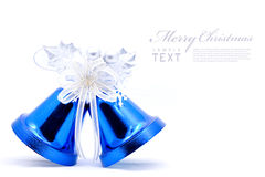 Christmas bells. Blue christmas bell and silver bow ribon on white background with copy space royalty free stock images