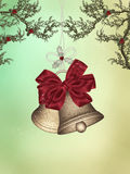 Christmas Bells. Golden christmas Bells with ribbon and mistletoe Royalty Free Stock Image