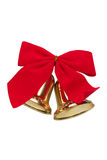 Christmas bells. With  a red bow isolated against white Royalty Free Stock Photo