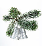 Christmas bells. Silver Christmas bells on the fir tree branch Royalty Free Stock Image