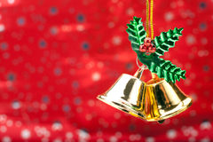 Christmas Bells. Two Gold Colored Christmas Bells Against A Holiday Background Stock Photos