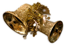 Christmas Bells. Two gold-toned bells adorned with other gold-colored Royalty Free Stock Images