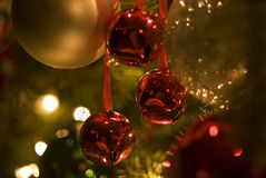 Christmas Bells. Soft-Focus Close-up of Colorful Ornaments, Bells and Lights on Christmas Tree Royalty Free Stock Image