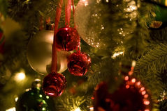 Christmas Bells. Soft-Focus Close-up of Colorful Ornaments, Bells and Lights on Christmas Tree Stock Image
