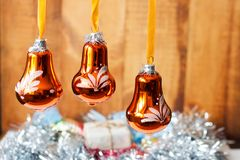 Christmas bells against defocused background . Christmas bells against defocused background Royalty Free Stock Images