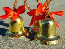 Christmas bells on the beach Royalty Free Stock Photo