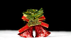 Christmas bells on black background Royalty Free Stock Photos