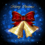 Christmas bells on blue background Stock Photos