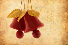 Christmas bells decoration. A pair of christmas decoration bells on grunge texture background with aged photo effect royalty free stock photos