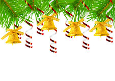 Christmas bells on fir branches Royalty Free Stock Photo