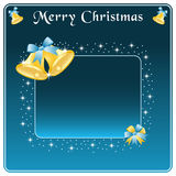 Christmas bells gold and bow. Christmas bells in gold, blue blow and stars. Copy space for text Royalty Free Stock Photo