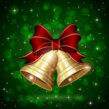 Christmas bells on green background. Background with Christmas bells, bow and snowflakes on green shiny background, illustration Royalty Free Stock Photography