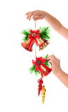 Christmas bells in hand Stock Image