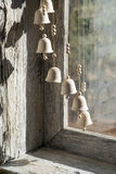 Christmas bells. Hanging in front of an old window Stock Image