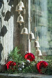 Christmas bells. Hanging in front of an old window Royalty Free Stock Photography
