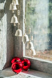 Christmas bells. Hanging in front of an old window Royalty Free Stock Photos