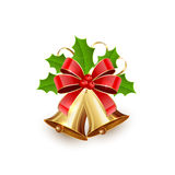 Christmas bells and holly berries Royalty Free Stock Image
