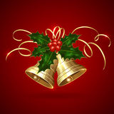 Christmas bells and holly berries Stock Photography