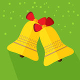 Christmas bells icon. Yellow Christmas bells. Flat design icon on green background Stock Image