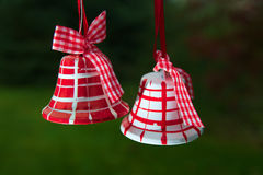 Christmas bells are landing 3. Christmas bells red and white on green background Stock Images