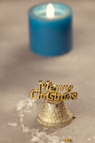 Christmas bells near burning candles Royalty Free Stock Photo