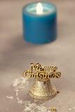 Christmas bells near burning candles Royalty Free Stock Photo