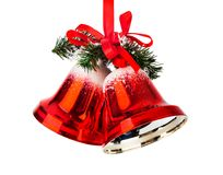 Christmas bells with a red bow. Isolated on white background Royalty Free Stock Photography