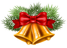 Christmas bells. With red ribbon and fir branches Stock Image