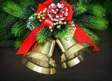 Christmas bells. With red ribbon and pine twigs Royalty Free Stock Photo