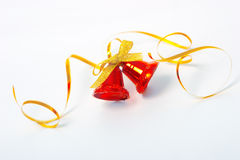 Christmas bells and ribbon. Red christmas bells on white background royalty free stock photography