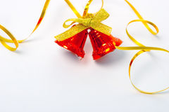 Christmas bells and ribbon. Red christmas bells on white background stock photography