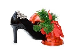 Christmas bells and sexy stilettos - clipping path. Sexy black stilettos and diamonds butterfly jewelry with Christmas red bells. Isolated over white with Royalty Free Stock Photography