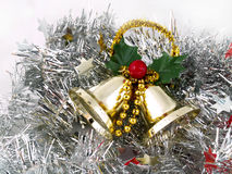 Christmas bells on silver tins Stock Photo