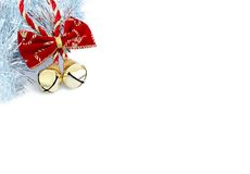 Christmas bells with silver tinsel. Christmas bells with red ribbon and silver tinsel on white background Royalty Free Stock Images