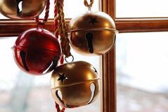 Christmas bells on snowy day. Decorative Christmas bells near a window on a snowy day Stock Photography