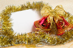 Christmas bells with tinsel and postcard Stock Images