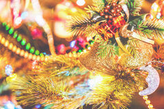 Christmas bells weigh on tree close-up Stock Photography
