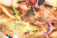 Christmas bells weigh on tree close-up Royalty Free Stock Image