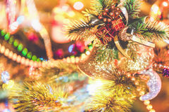Christmas bells weigh on tree close-up Stock Image