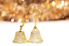 Christmas bells on white. Two gold Christmas bells on white Royalty Free Stock Photos