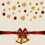 Christmas bells on white knitted pattern Royalty Free Stock Images
