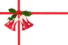 Christmas Bells With Ribbon And Ilex Royalty Free Stock Photos