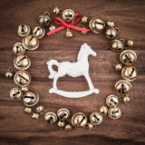 Christmas, bells on wood, christmas decorations, rocking horse Stock Photos